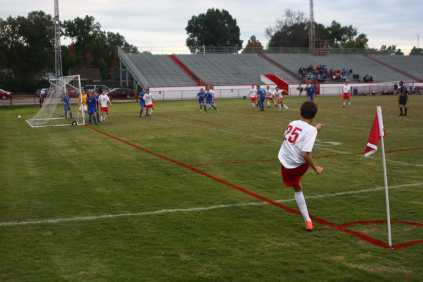 Riley Hook (10, #25) takes a corner kick from the home side corner