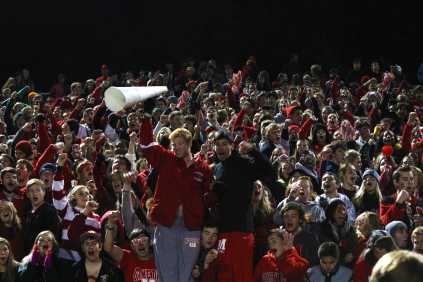 The crowd cheers when Manual scored their third touchdown