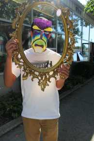 """Juan Afable (11, MST) laughs behind his hand made """"mirror"""" mask. Photo by Olivia Cook"""