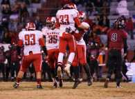 Chris Dyer (11, #33) celebrates a favorable play with teammates.