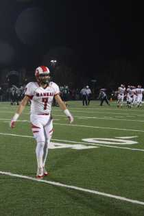 Jake Rist (#7) walks off the field as Manual prepares to prevent a field goal from Trinity.