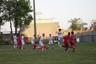Male player with the header on the offensive end. Photo by Cicada Hoyt.