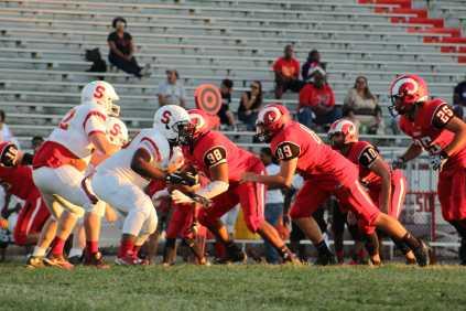 The defense powers through Seneca offensive line. Photo by Emma Bornschein.