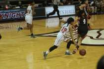 Tyonne Howard (12, #12) dribbles up the court against GRC. Photo by Cicada Hoyt.