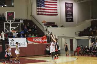 Aniah Griffin (12, #21) plays defense on GRC's final shot attempt. Photo by Cicada Hoyt.