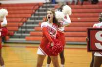 Taylor Currie (12, YPAS) cheering for the Crimsons at the Boys halftime. Photo by Jade Broderick.