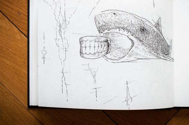 Skizze mit einem Hai der eine Zahnprothese jagt oder ausspuckt