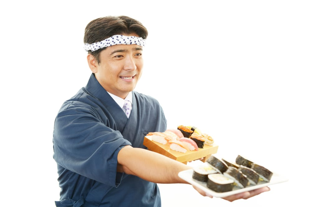 japanese chef serving sushi