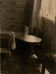 "Kid in a bath, or ""This is worth the price of admission,"" or ""If your eyes are dry then your heart is dead,"" Bridgeport, CT, about 1898. Photographed by Harriet V. S. Thorne, CHS collection, gift of the Rosalie Thorne McKenna Foundation."