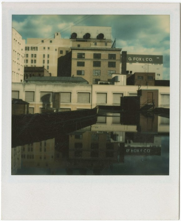 Richard Welling. G. Fox & Co. sign and tops of surrounding buildings from rooftop, Hartford. 2012.284.113