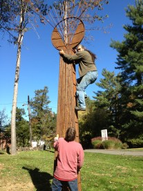 Vicente Garcia, the artist whose works are featured on the CHS grounds for the month of November in conjunction with Open Studio Hartford shows off his climbing skills scaling his own artwork.