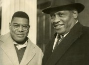 Paul Robeson and young man. Note: the photograph indicates the young man may be Robeson's son, Paul Jr.