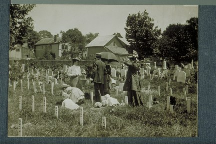 Children decorate veterans' graves, Spring Grove Cemetery, Hartford, 1909. CHS X.2000.8.45 (CD 0542 img0022)
