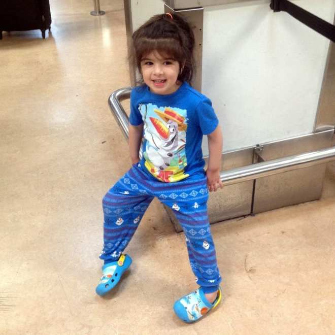 girl wearing Olaf t-shirt Olaf jammies Olaf crocs