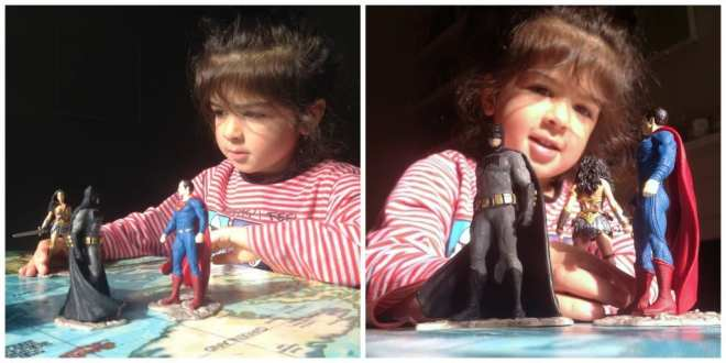 girl playing with Wonder Woman and Batman v Superman Schleich figurines