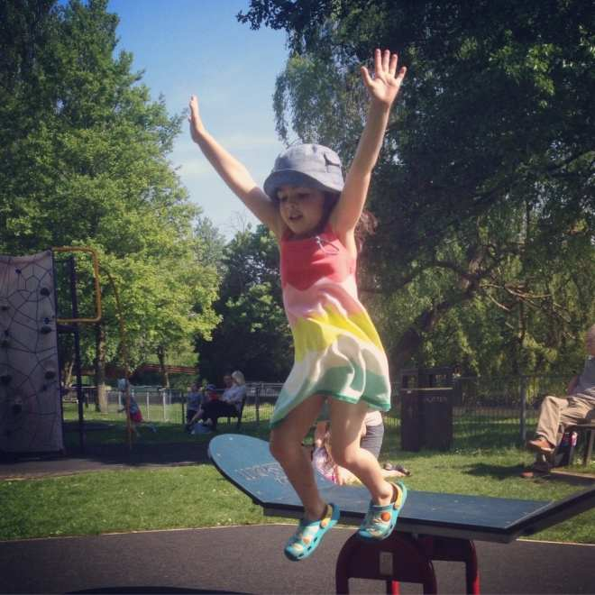 Girl leaping in playground