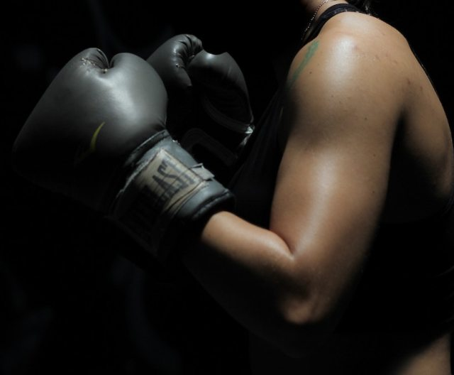 Lady with boxing gloves