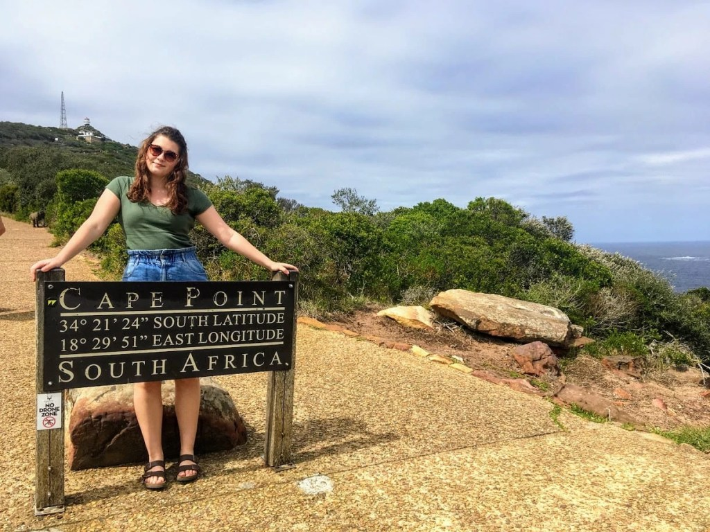 Girl stood by the Cape Point signpost in South Africa