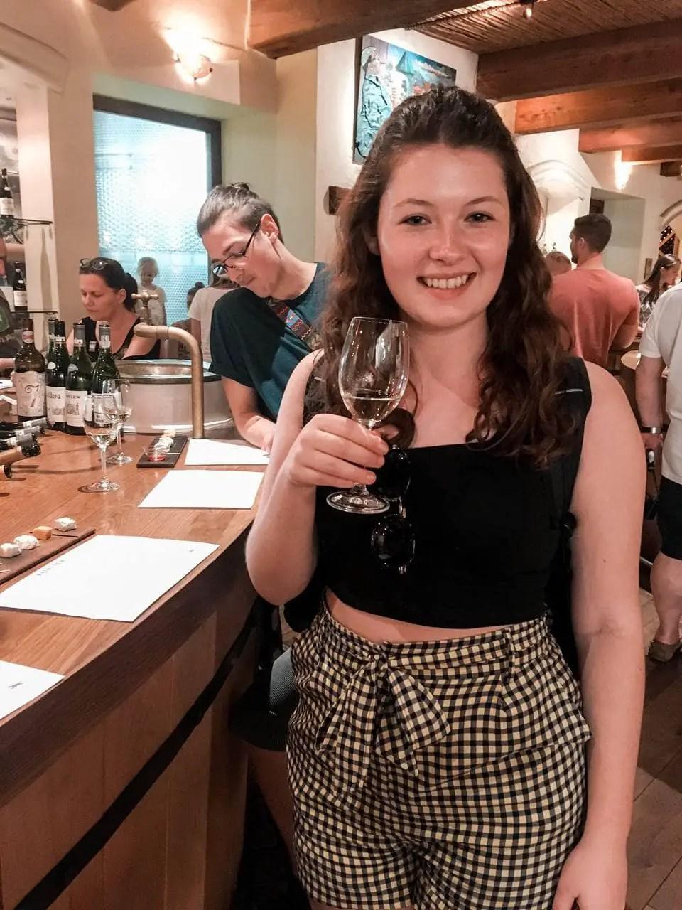 Girl on a Stellenbosh Wine Tour sampling white wine