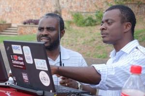 Emmanuel Togo and Ato Yawson compare readings.