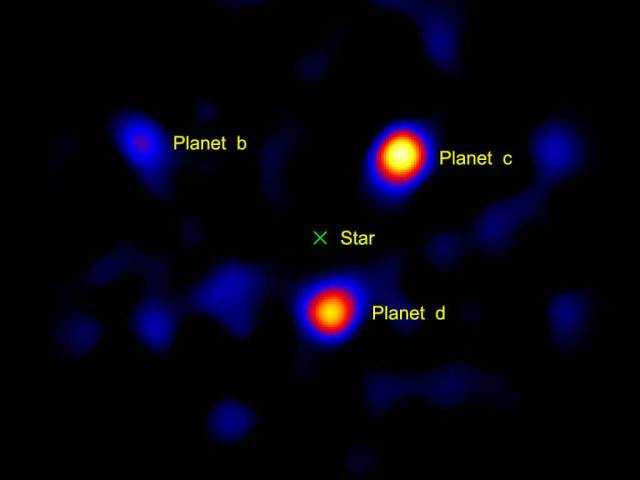 """NASA/JPL-Caltech/Palomar Observatory - http://www.nasa.gov/topics/universe/features/exoplanet20100414-a.html This image shows the light from three planets orbiting a star 120 light-years away. The planets' star, called HR8799, is located at the spot marked with an """"X."""" This picture was taken using a small, 1.5-meter (4.9-foot) portion of the Palomar Observatory's Hale Telescope, north of San Diego, Calif. This is the first time a picture of planets beyond our solar system has been captured using a telescope with a modest-sized mirror -- previous images were taken using larger telescopes. The three planets, called HR8799b, c and d, are thought to be gas giants like Jupiter, but more massive. They orbit their host star at roughly 24, 38 and 68 times the distance between our Earth and sun, respectively (Jupiter resides at about 5 times the Earth-sun distance)."""