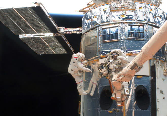 NASA sent astronauts to fix or upgrade the Hubble Space Station five times since it launched in 1993. As of now, it looks like JWST will be too far away to ever be serviced should something go wrong. This 2009 shows astronauts John Grunsfeld, left, and Andew Feustel working on the HST during the first of five STS-125 spacewalks. (NASA)