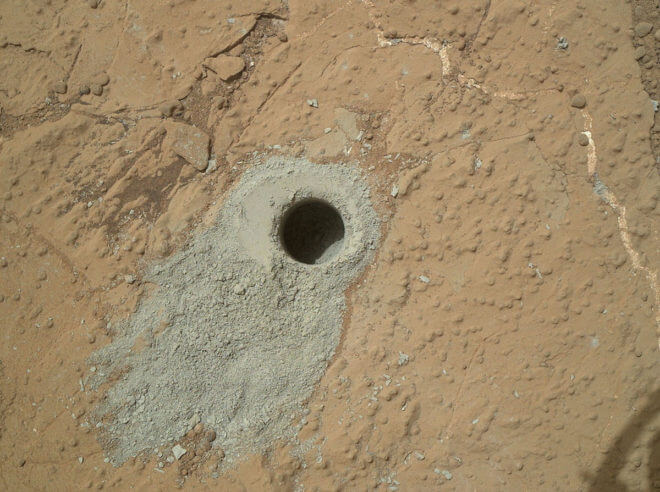 "The hole drilled into this rock target, called ""Cumberland,"" was made by NASA's Mars rover Curiosity on May 19, 2013. Credit: NASA/JPL-Caltech/MSSS"