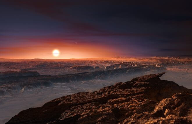 This artist's impression shows a view of the surface of the planet Proxima b orbiting t he red dwarf star Proxima Centauri, the closest star to the Solar System. The double star A lpha Centauri AB also appears in the image to the upper-right of Proxima itself. Proxima b is a little more massive than the Earth and orbits in the habitable zone around Proxima Centauri, wh ere the temperature is suitable for liquid water to exist on its surface. Credit: ESO/M. Kornmesser