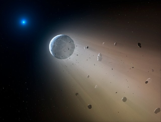 In this artist's conception, a tiny rocky object vaporizes as it orbits a white dwarf star. Astronomers have detected the first planetary object transiting a white dwarf using data from the K2 mission. Slowly the object will disintegrate, leaving a dusting of metals on the surface of the star. (NASA)