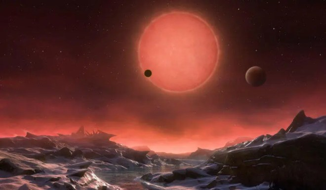 This artist's impression shows an imagined view from the surface one of the three planets orbiting an ultracool dwarf star just 40 light-years from Earth that were discovered using the TRAPPIST telescope at ESO's La Silla Observatory. (M. Kornmesser/ESO)