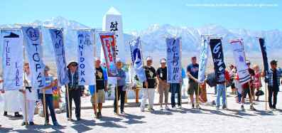 A banner represents each of the American concentration camps in which Japanese Americans were unjustly incarcerated during World War II