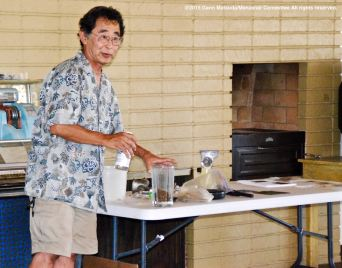 Dr. Glenn H. Kageyama demonstrating how to make rubber from the Guayule plant at the program on the Manzanar Guayule Rubber Project, August 30, 2015, Gardena, California.