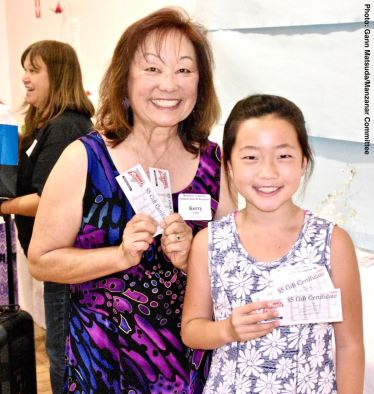 The fourth of the raffle prizes won by Sara Omura (right), shown here with Manzanar Committee member Kerry Cababa