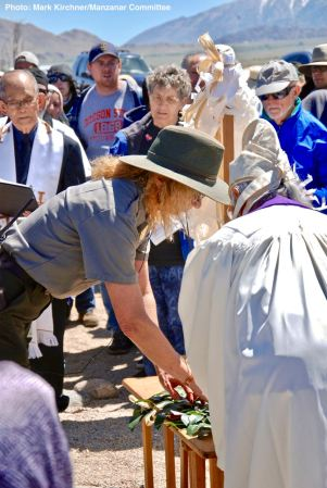 Manzanar National Historic Site Ranger Patricia Biggs (left) participates in the Shinto purification rite with Rev. Alfred Tsuyuki of the Konko Church of Los Angeles.