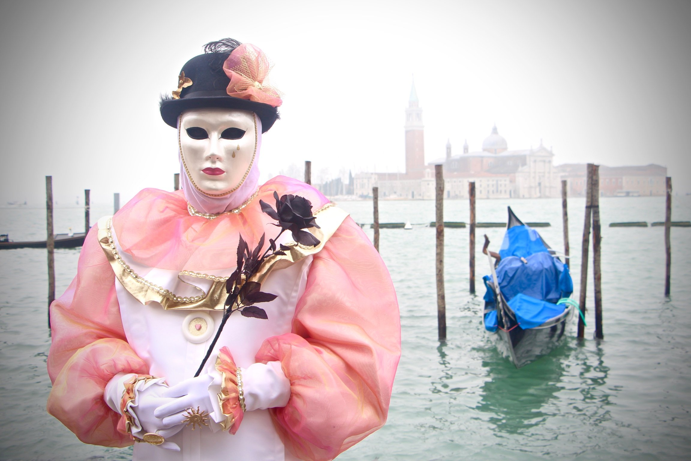 Venice Carnival mask with gondola background