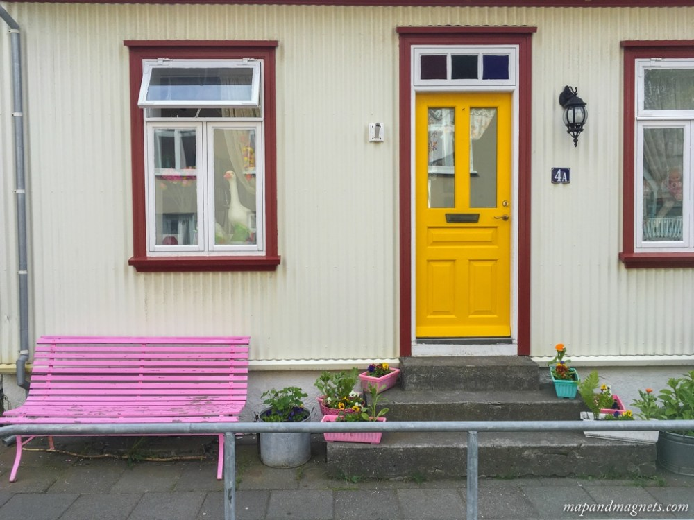 Colorful door and bench on the streets of Reykjavik