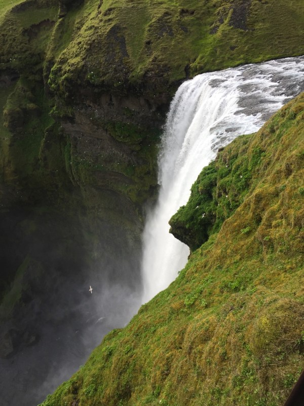Hiking up to the top of Skogafoss in Iceland