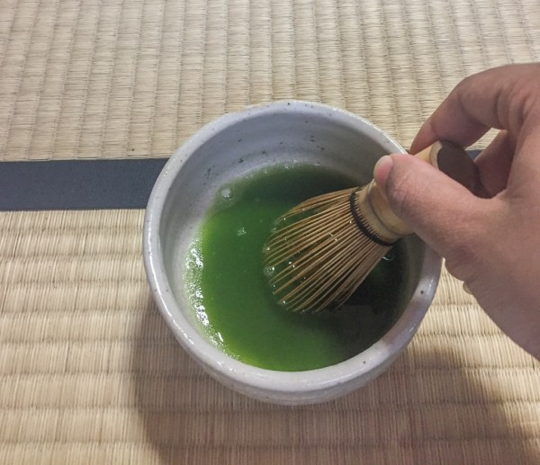 Mixing tea as part of the tea ceremony in Japan