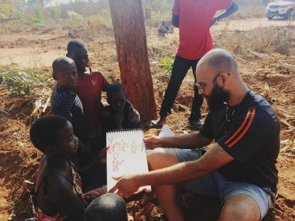 Shikhant, the illustrator, with African kids during the Great African Caravan