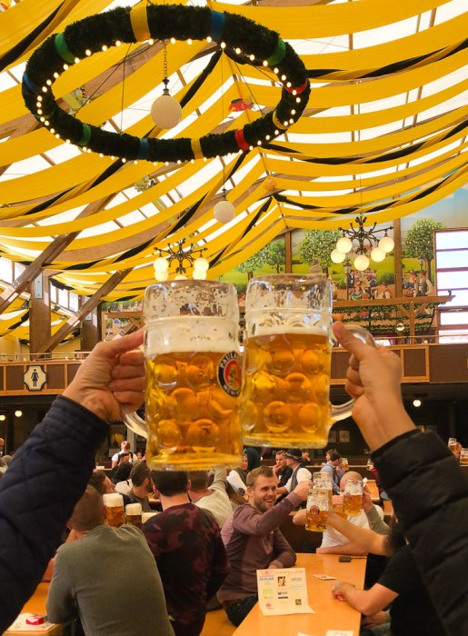 Prost with beer glasses in an Oktoberfest tent
