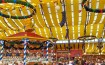 The festive and colorful vibe in an Oktoberfest tent