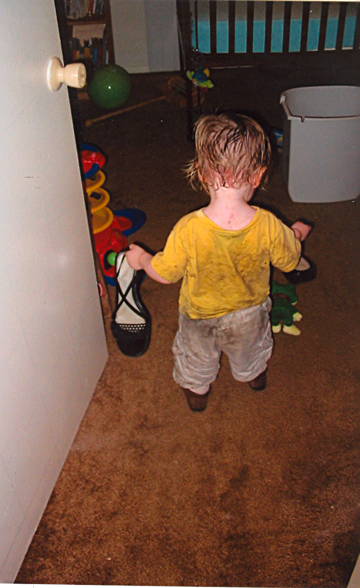 the kiddo after playing in the rain--2004