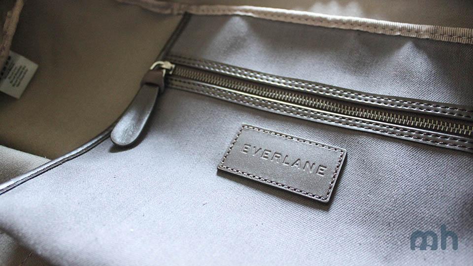 Internal organization consists of a flat zippered pouch.