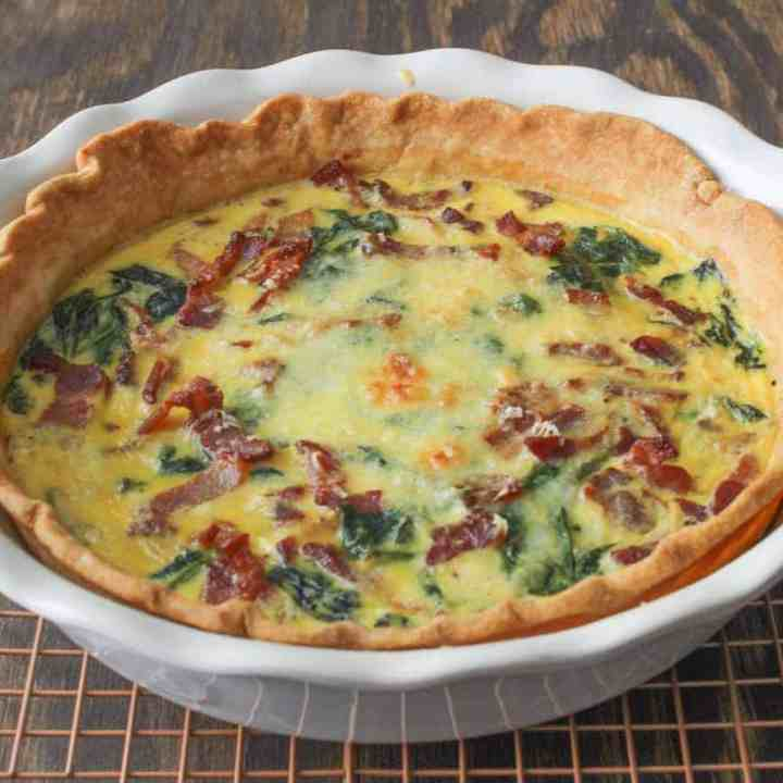 spinach bacon quiche on cooling rack