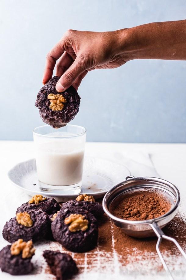 dipping chocolate brownie cookies in milk