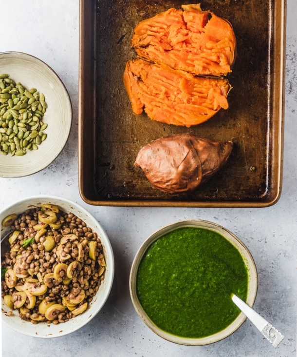 Ingredients prepped  - roasted sweet potatoes, lentils with olives and Chile-cilantro sauce