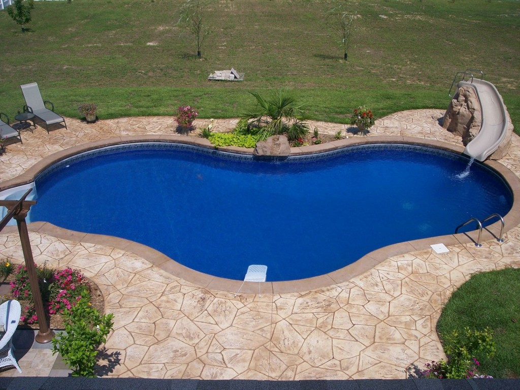 Decorative Concrete Ideas to Add Unique Effect to Your ... on Pool Deck Patio Ideas  id=95909