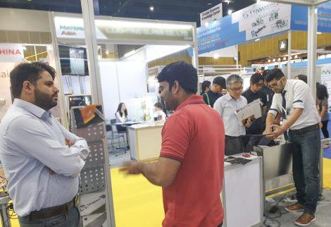 MapleJet representatives and visitors at Propak Asia show