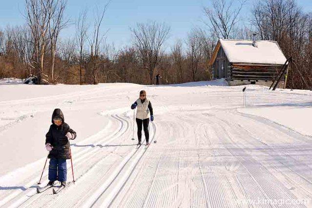 Skiing in Ottawa region white snow sunshine woman and child log cabin