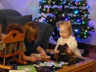 Theresa helps cousin Sienna with her dolls